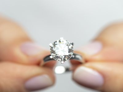 Woman Holding A Diamond Ring