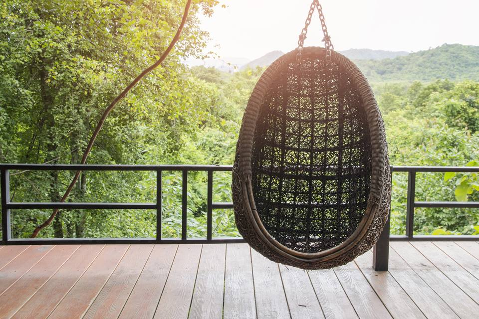 hanging chair in the balcony with nature view.