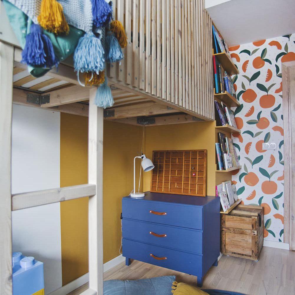Bedroom with orange wallpaper