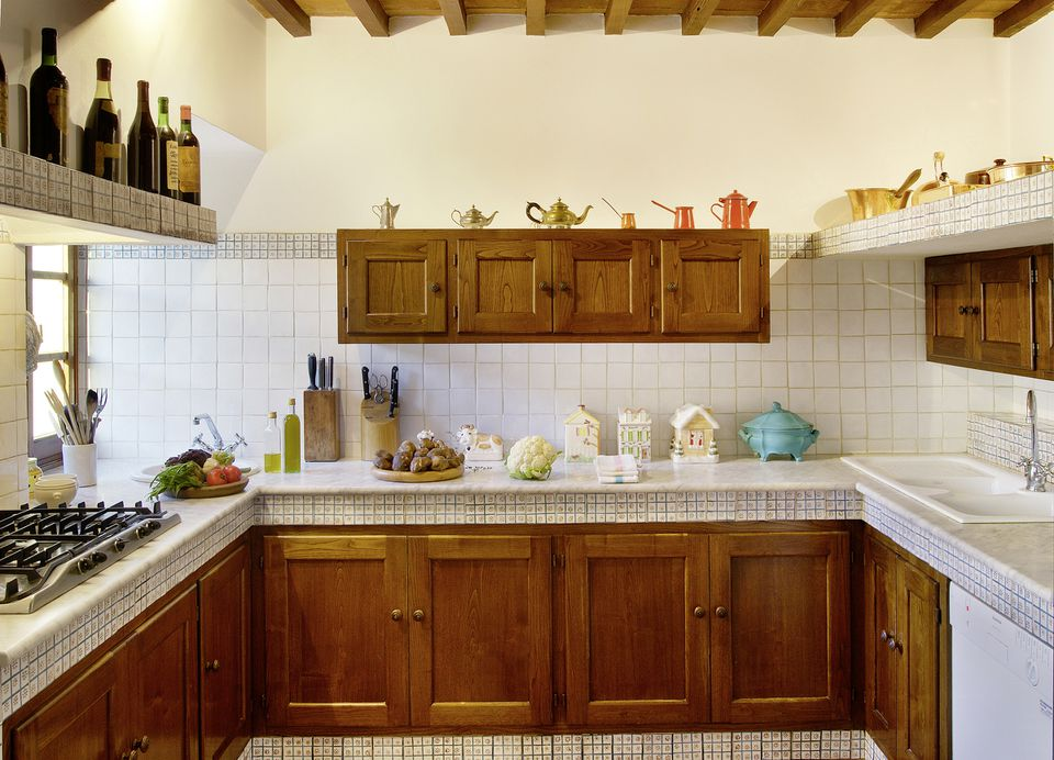 Wooden and marble kitchen in a beautiful italian rustic house