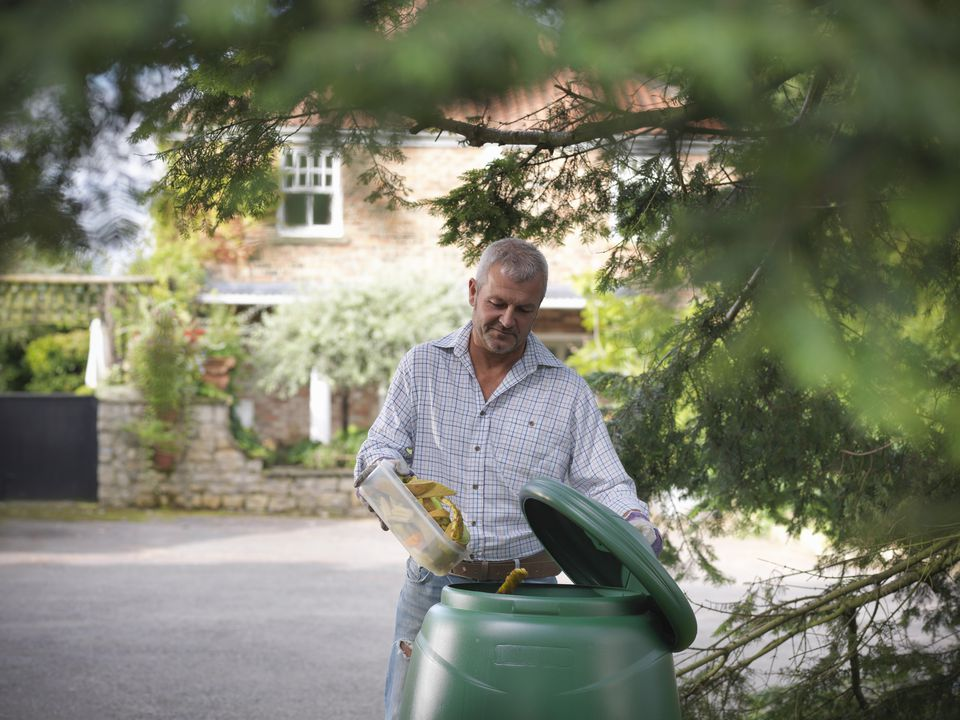 Man using compost bin