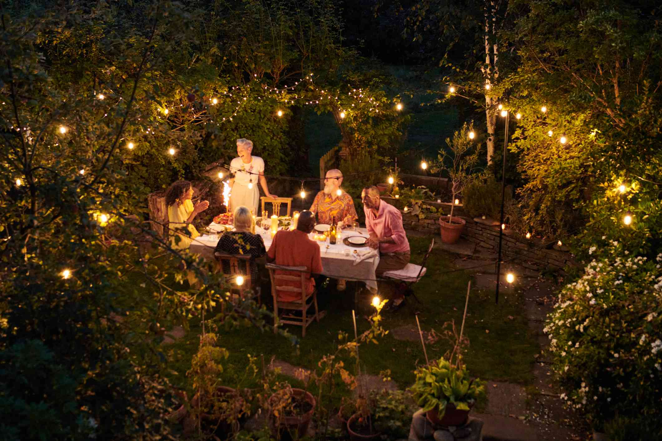 A group of friends at an outdoor dinner party