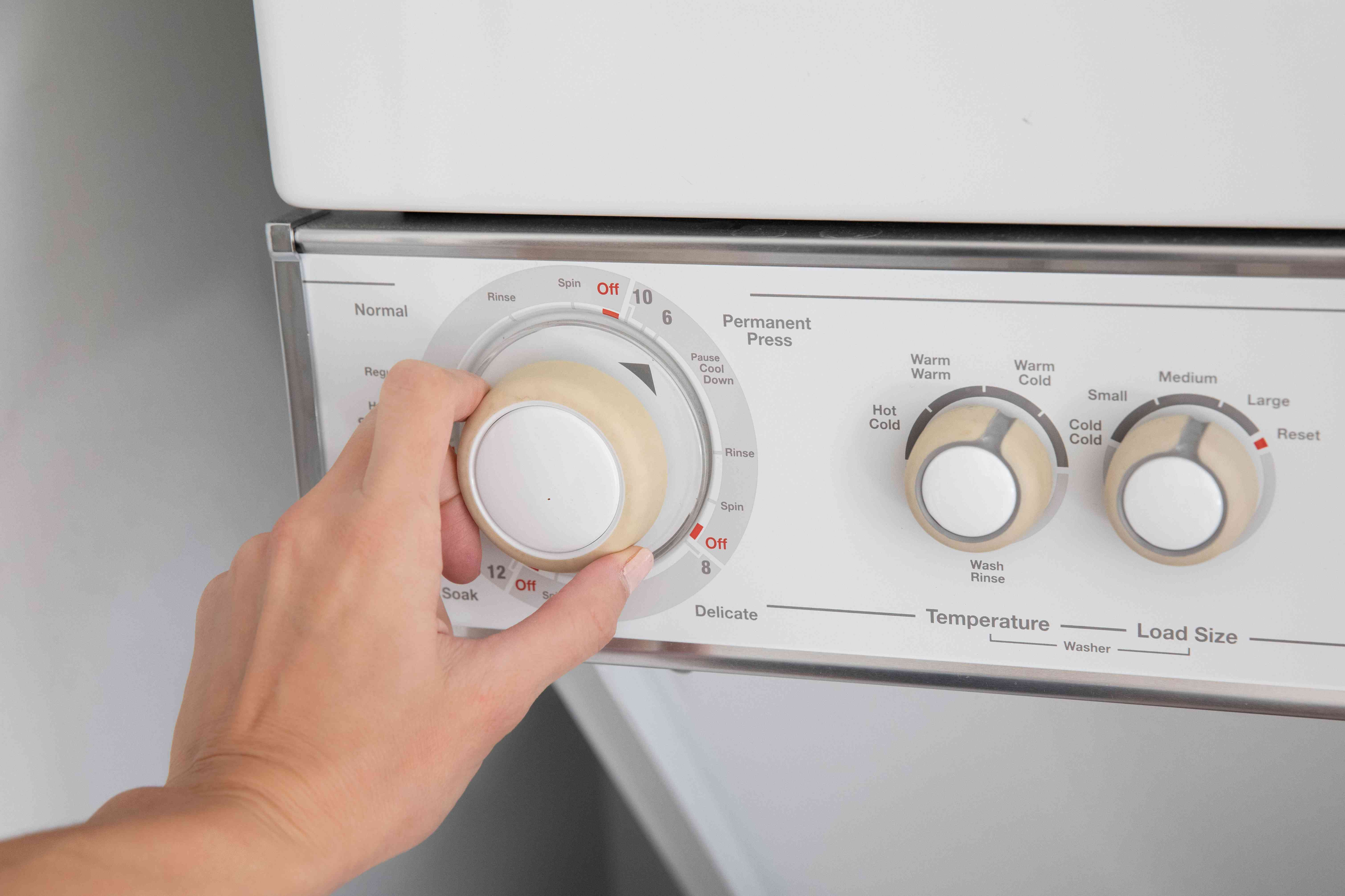Washing machine set to permanent press for acrylic clothes