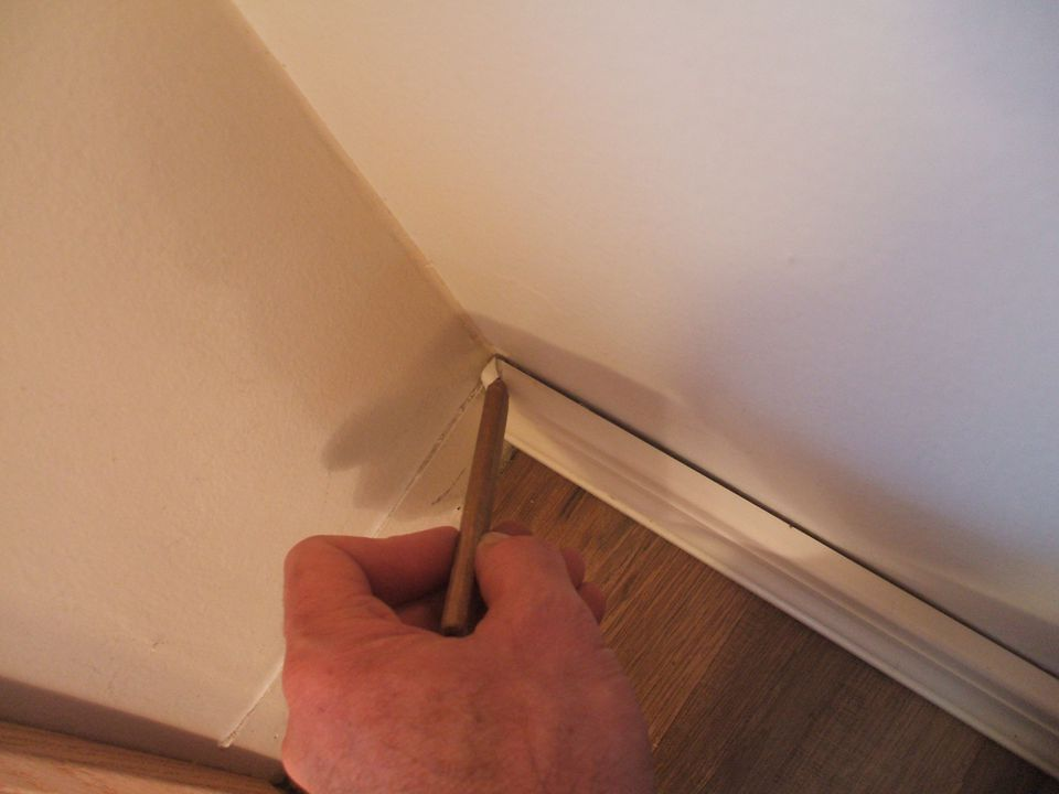 Mark Cut Direction on First Baseboard
