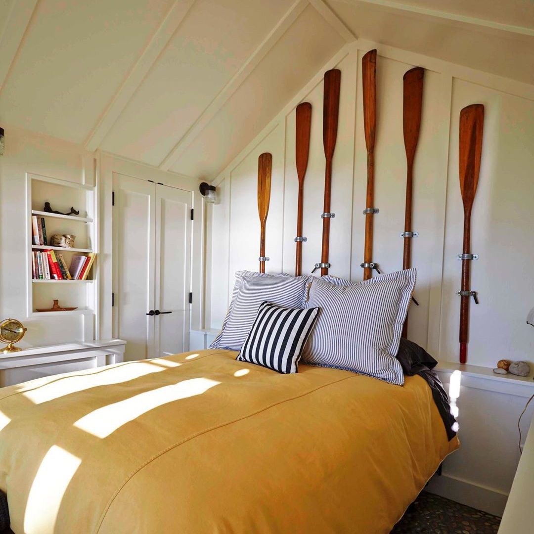 Lakehouse bedroom with paddles