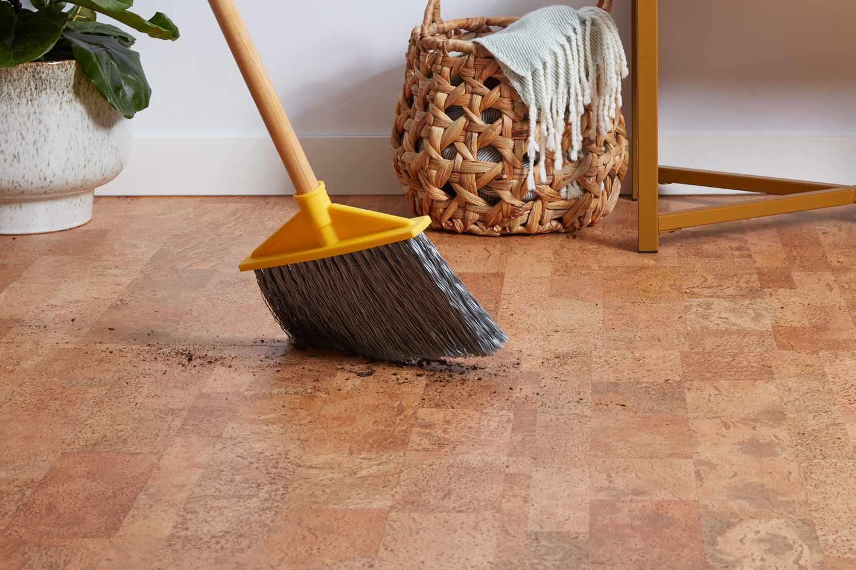 sweeping debris off a cork floor