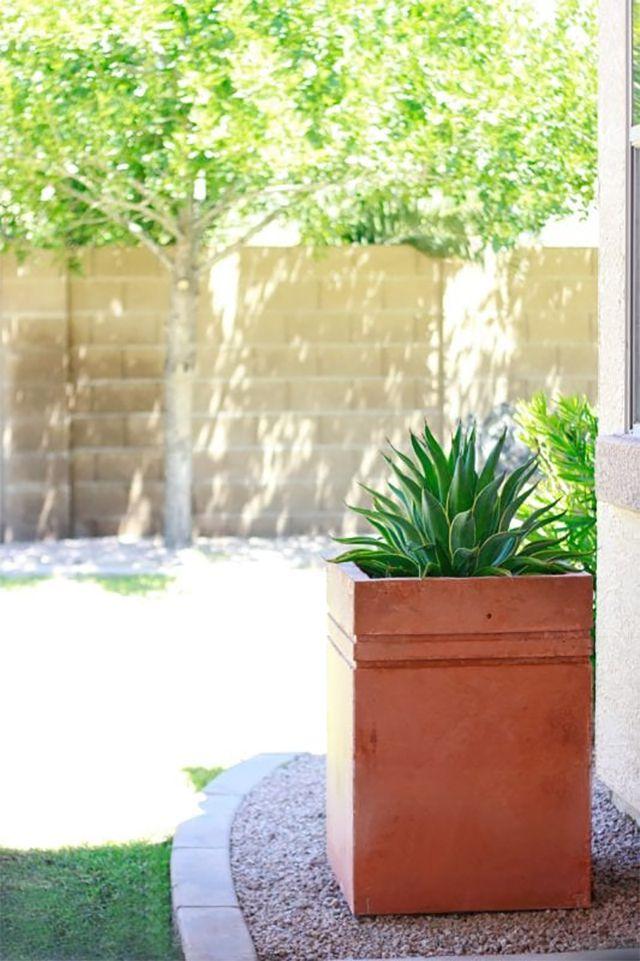 A tall concrete planter