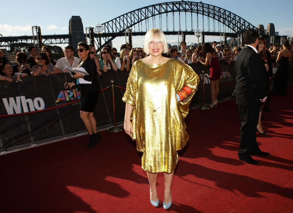 Woman in Gold Lame Dress