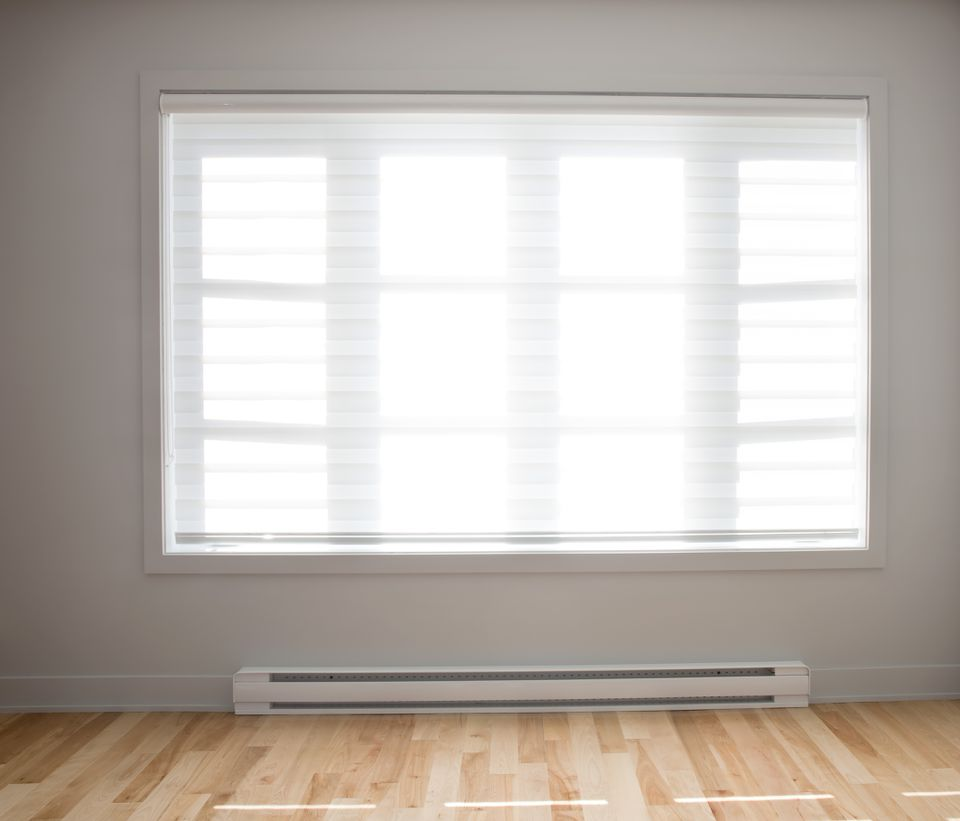 Large residential window with wooden floors