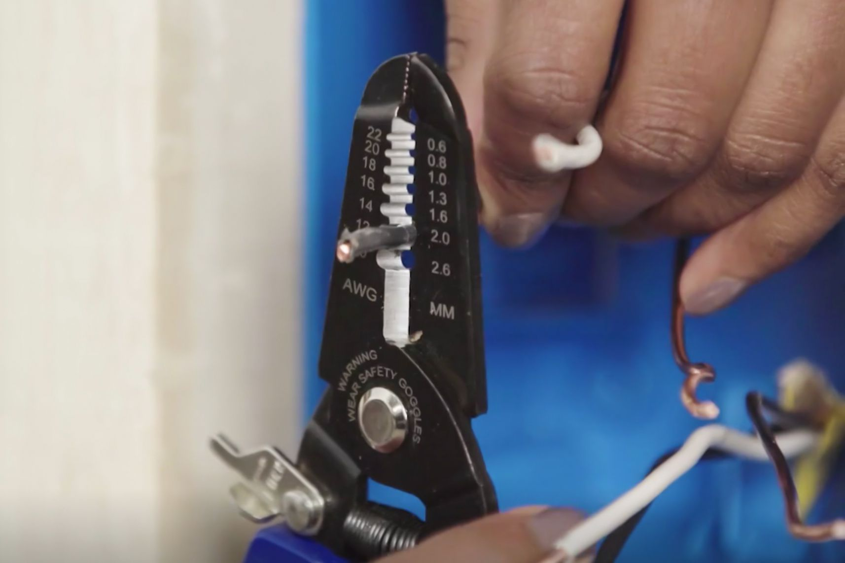 Wire screws clamped to secure cables
