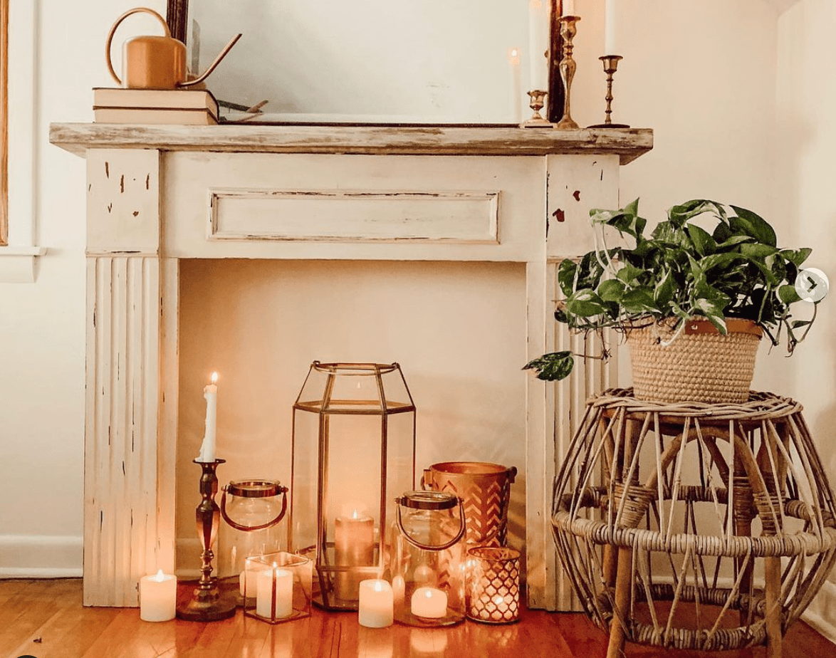 lanterns and candles in fireplace