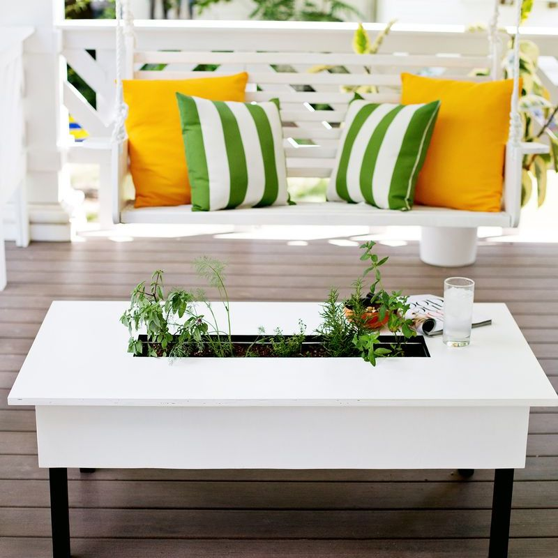 A coffee table with an herb planter box