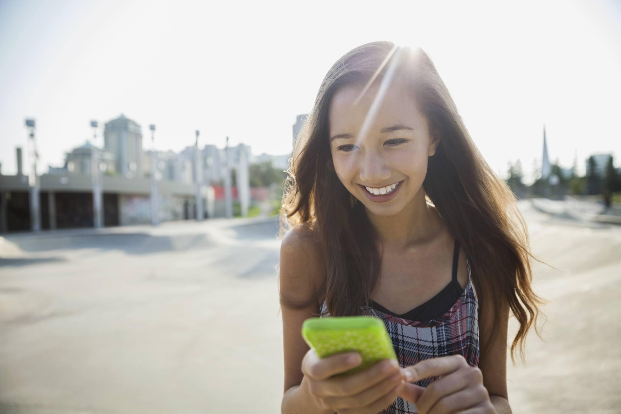 Teenage girl on her smart phone