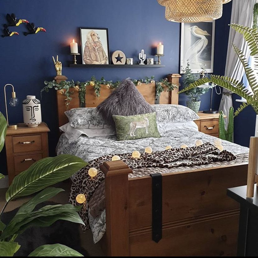 Blue bedroom with lots of plants