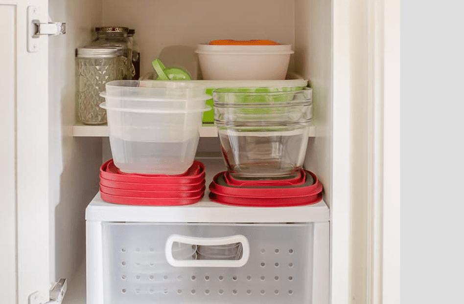 Organize tupperware in a cabinet