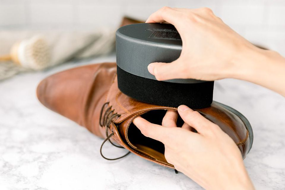 person buffing a shoe