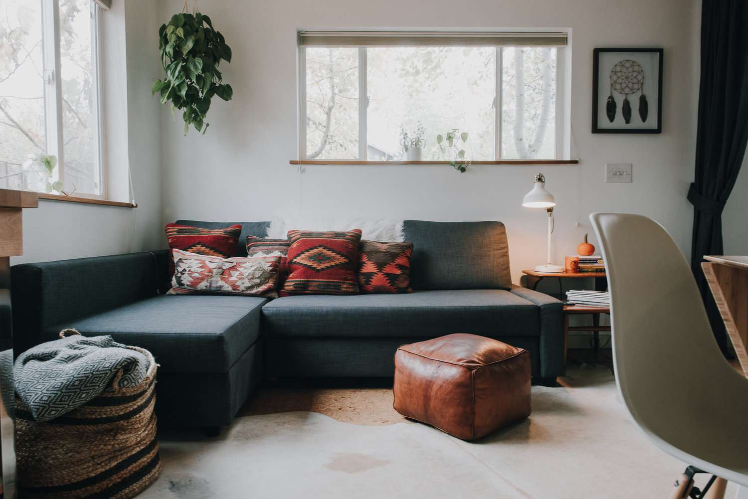 A gray sectional couch in a white room.