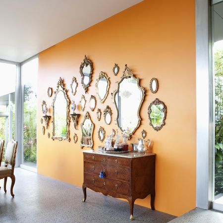 Grouping Of Antique Mirrors On Solid Wall