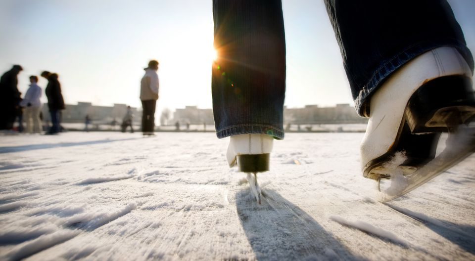 Ice skating with speed towards sun in Holland
