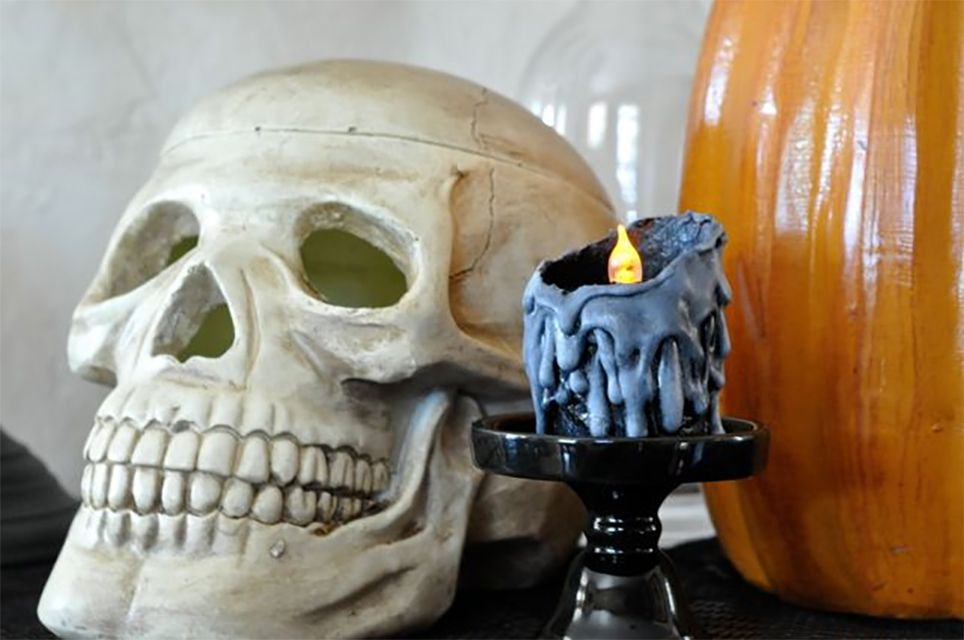 A black candle and a skull