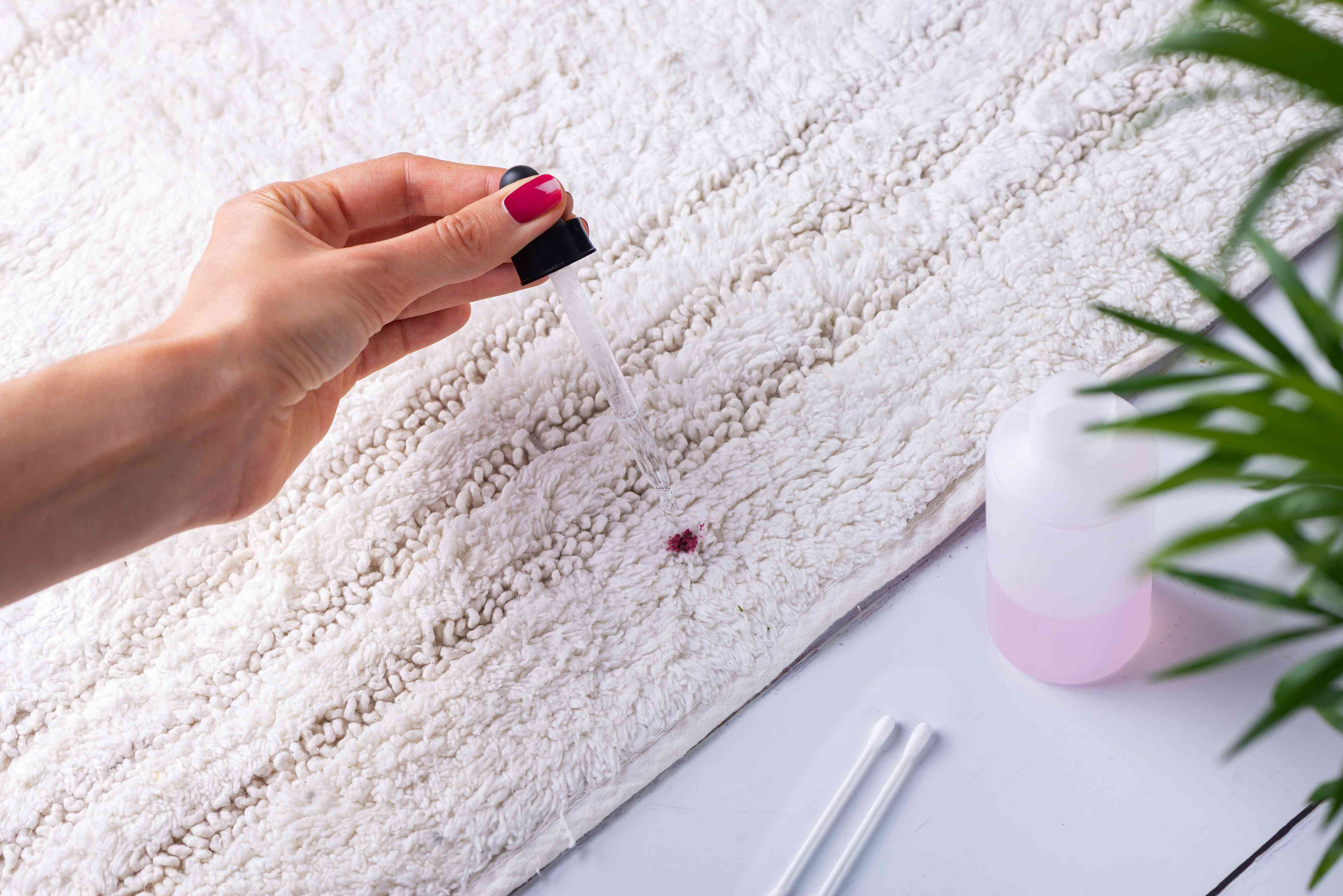 applying acetone to the carpet