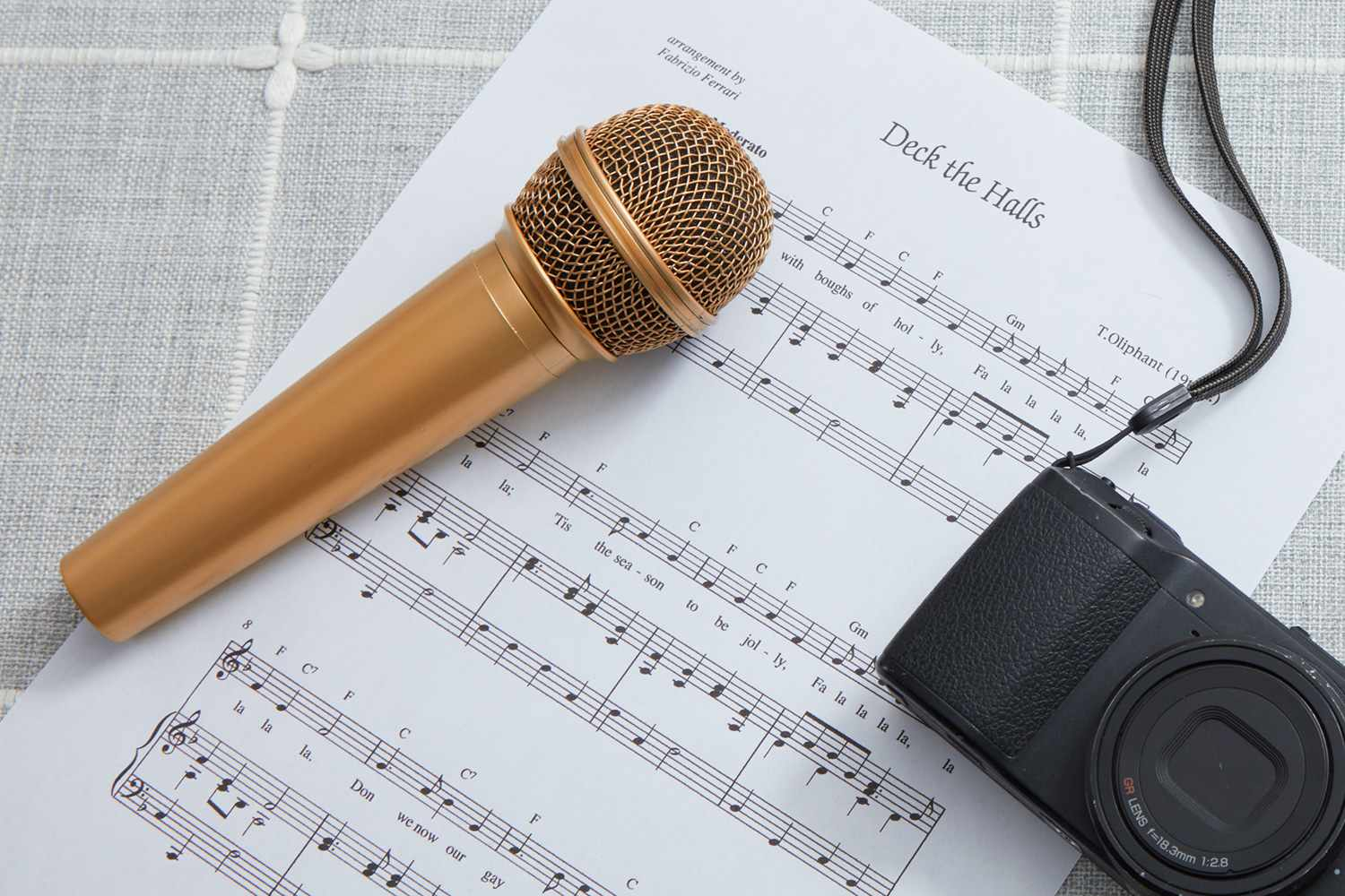 Deck the Halls sheet music and microphone for talent show