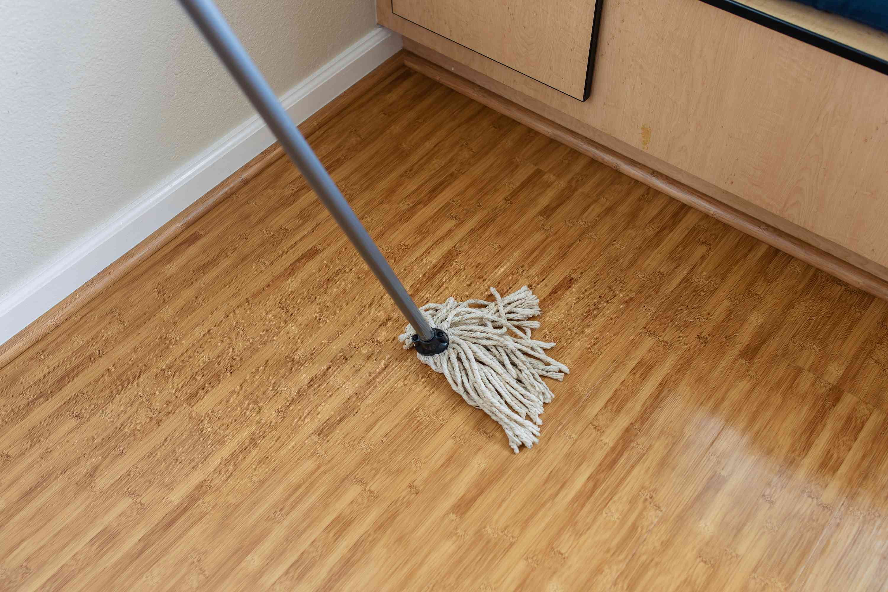 Continuing to mop the floor