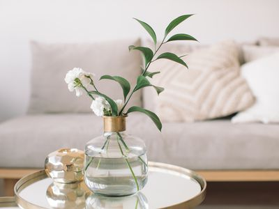 fresh flowers in a vase on a table in living room