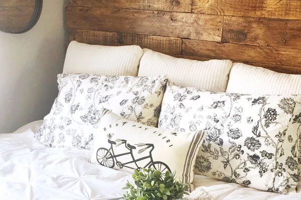 A close-up of a headboard made of pallets