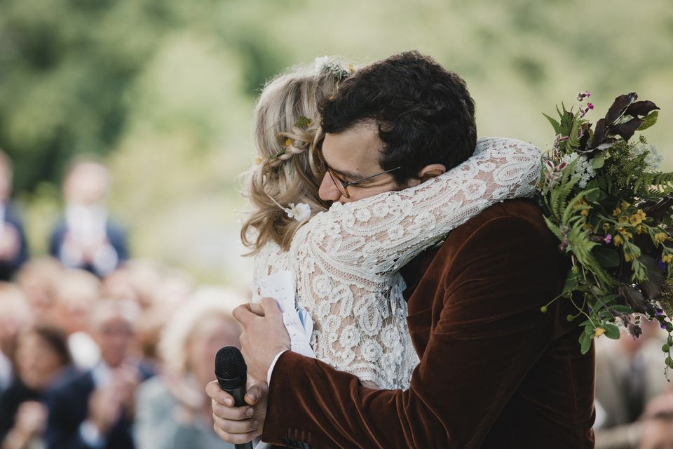Newlyweds hugging during wedding ceremony