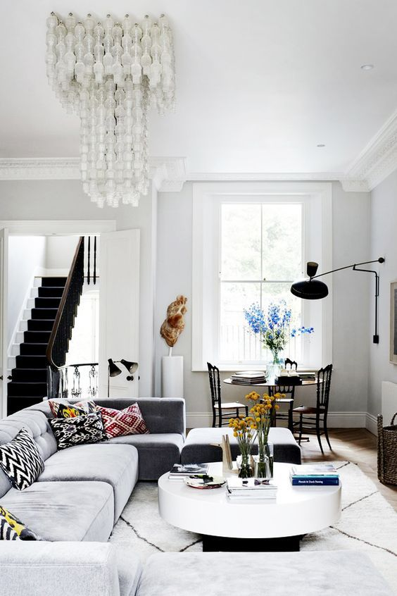 Modern room in black and white with long crystal chandelier