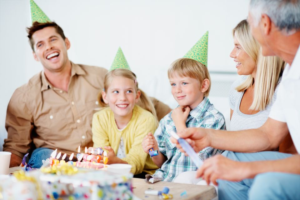 Multi-generational family celebrating a young kid's birthday