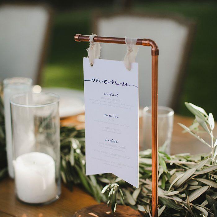 wedding menu sign on copper bar