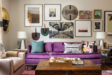 Beth Diana Smith's Irvington, NJ living room features a purple sofa in her eclectic maximalist style