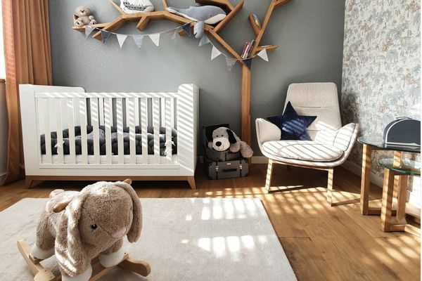 gray nursery with tree shelf