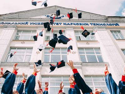 Grads throwing their caps up