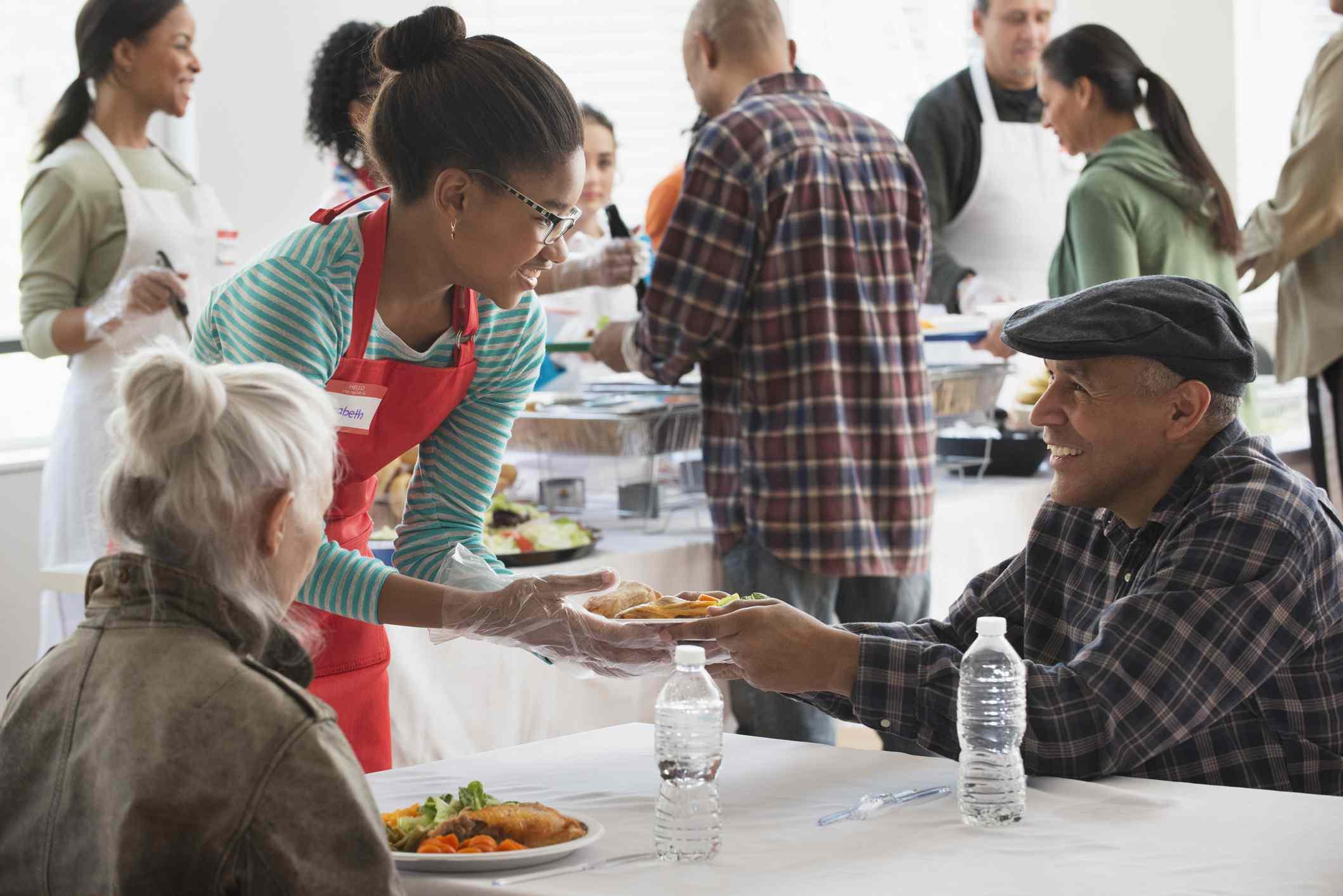 Teen volunteering at a food drive
