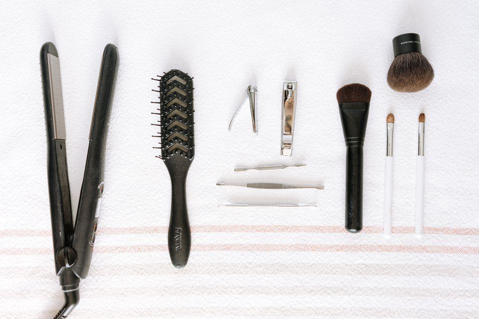 beauty items neatly arranged on a towel