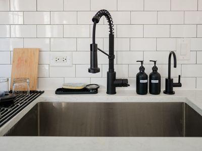 Kitchen sink with hot water dispenser tap