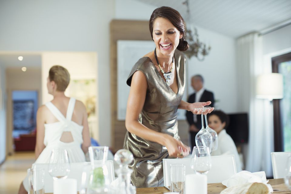 Woman setting table for party