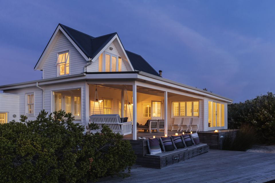 Illuminated white home showcase exterior at night