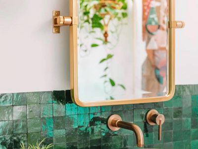 Bathroom with green tiles and pink cement sink