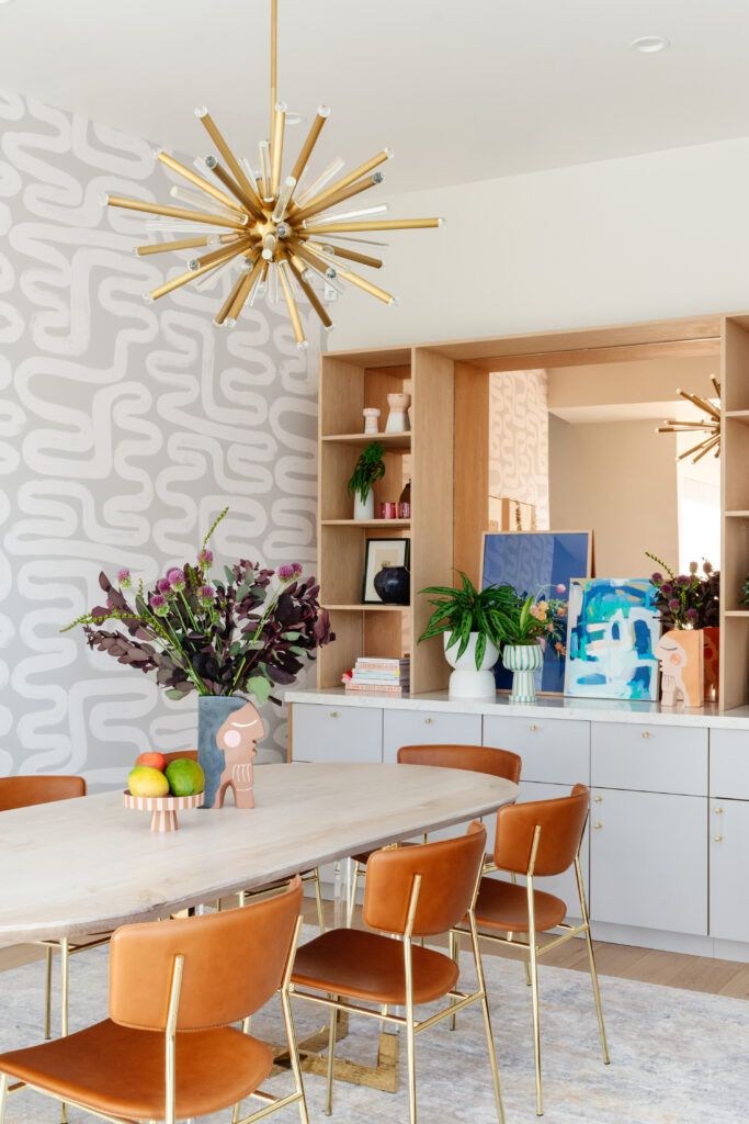 dining room with swirly wallpaper and artwork