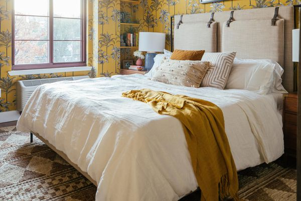 gorgeous, well-made bed with styled throw pillows