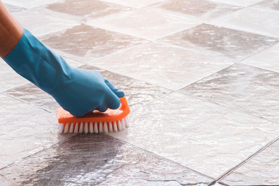 person scrubbing a bathroom floor