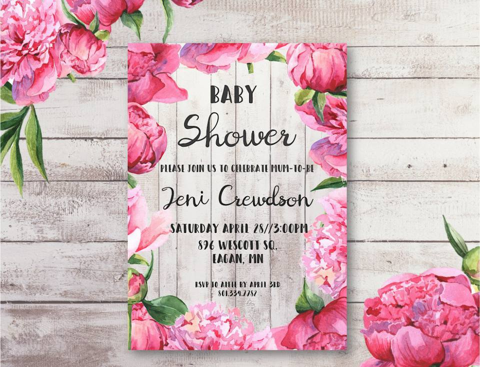 A pink floral baby shower invitation