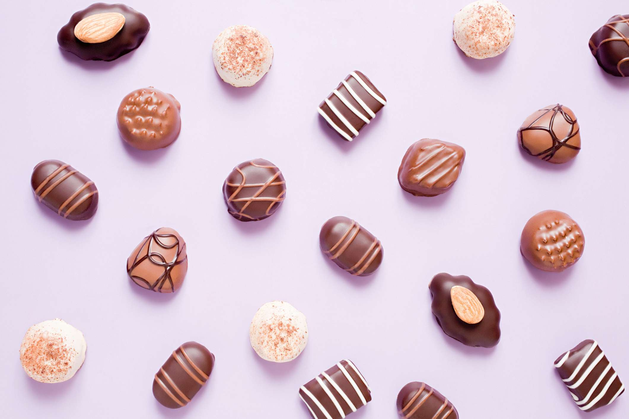 An assortment of chocolates laid out on purple paper