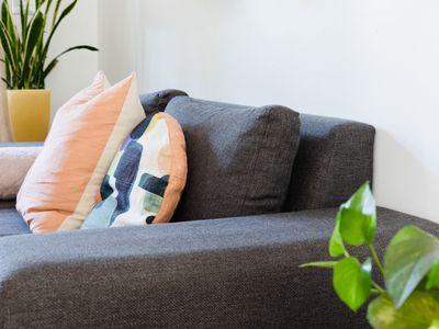 side angle view of a charcoal gray sofa