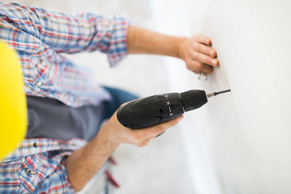 Man using cordless screwdriver