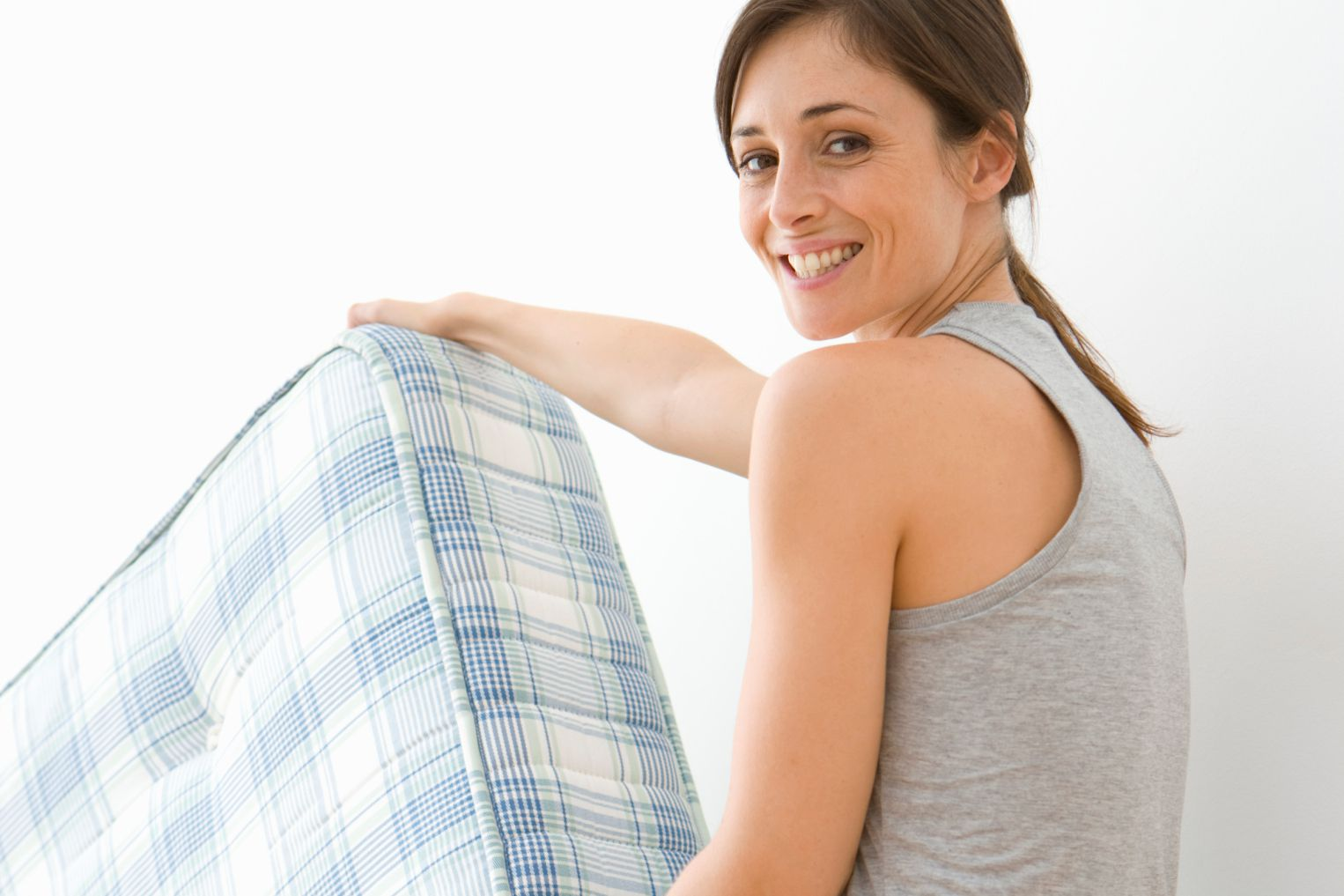 Woman moving mattress